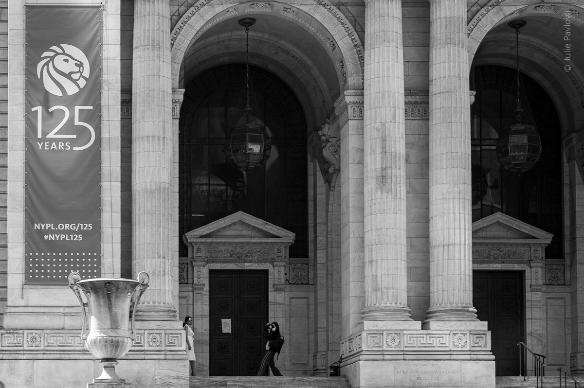 A photographer is taking pictures during quarantine. NYPL Streets of Manhattan, New York, during COVID-19. (04/26/2020 by Julie Pavlova Photography)