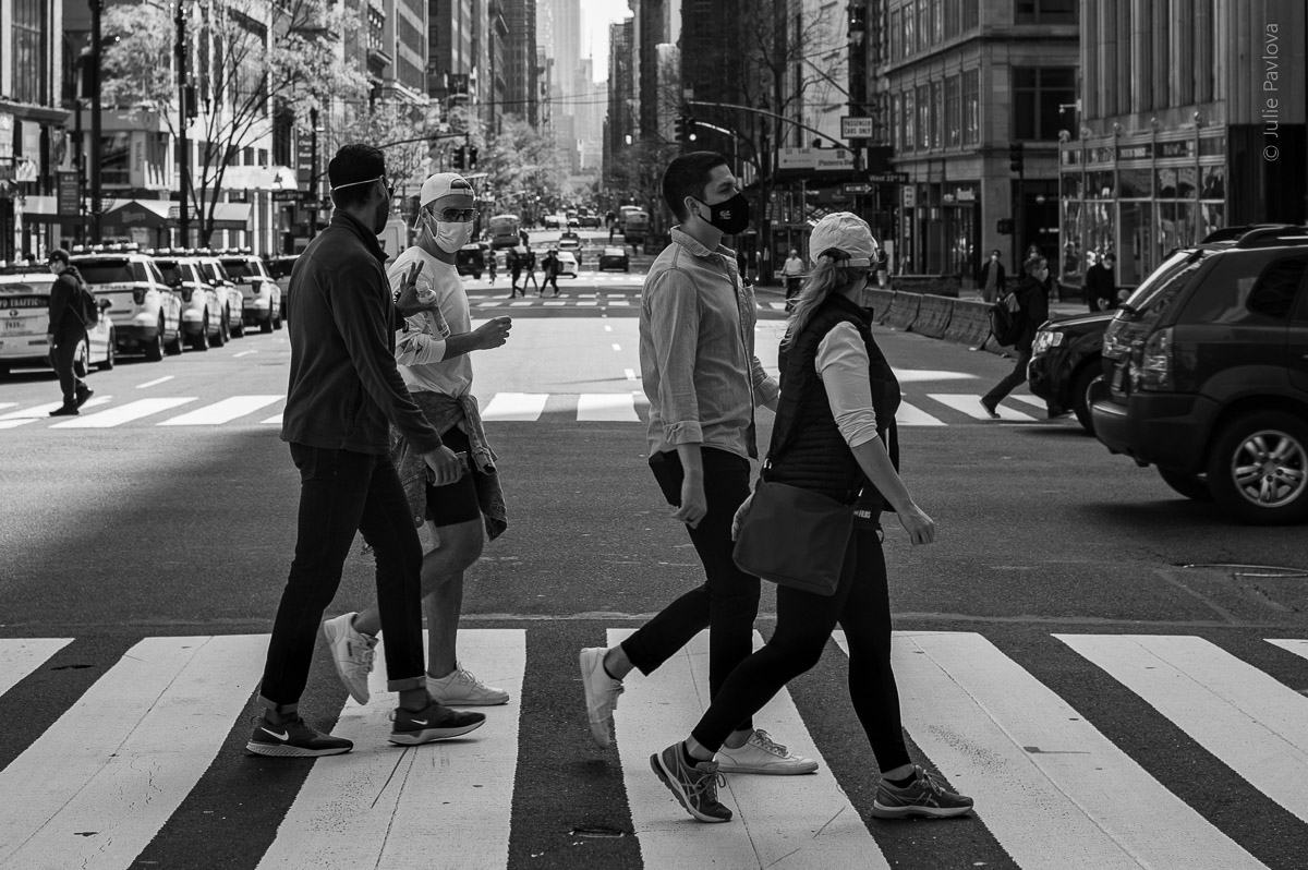 People in masks crossing a street. Manhattan, New York, during COVID-19. Quarantine (04/26/2020 by Julie Pavlova Photography)