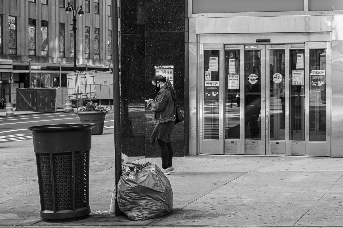 Woman in a mask on a sidewalk. Streets of Manhattan, New York, during COVID-19. (04/26/2020 by Julie Pavlova Photography)