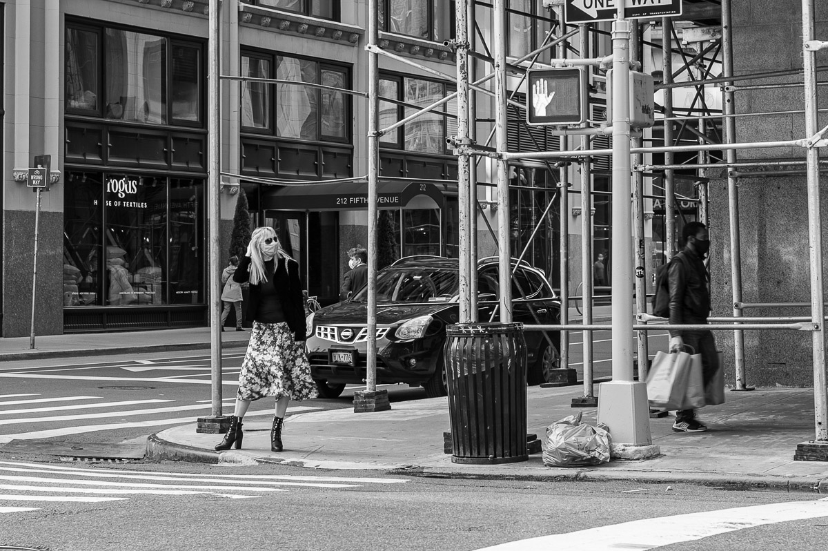 Woman in a mask crossing a street. Streets of Manhattan, New York, during COVID-19. (04/26/2020 by Julie Pavlova Photography)