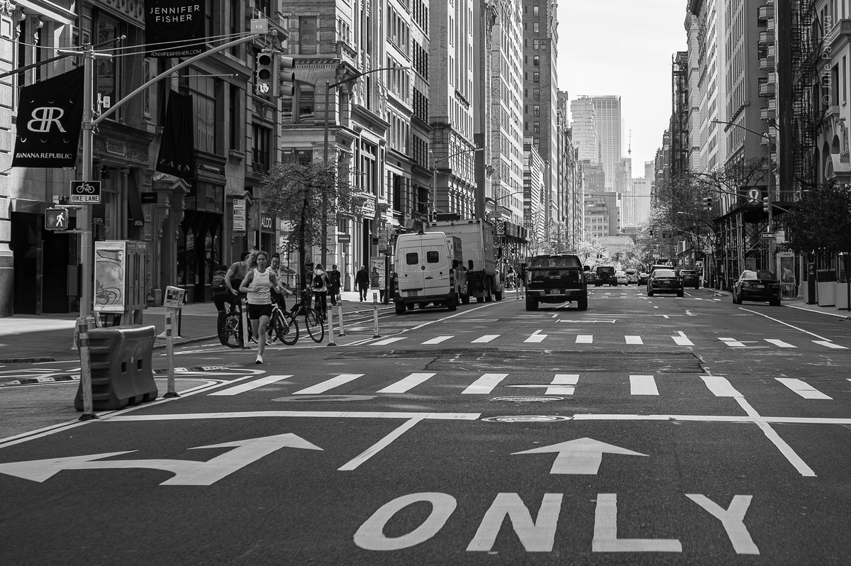 Woman running on an empty street of Manhattan, New York, during COVID-19. (04/26/2020 by Julie Pavlova Photography)