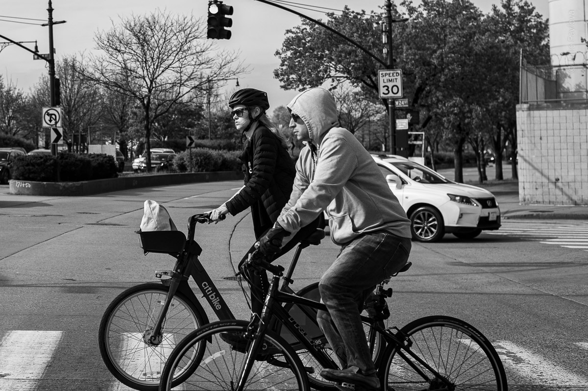 Bicyclists crossing a road. Manhattan, New York, during COVID-19. (04/26/2020 by Julie Pavlova Photography)