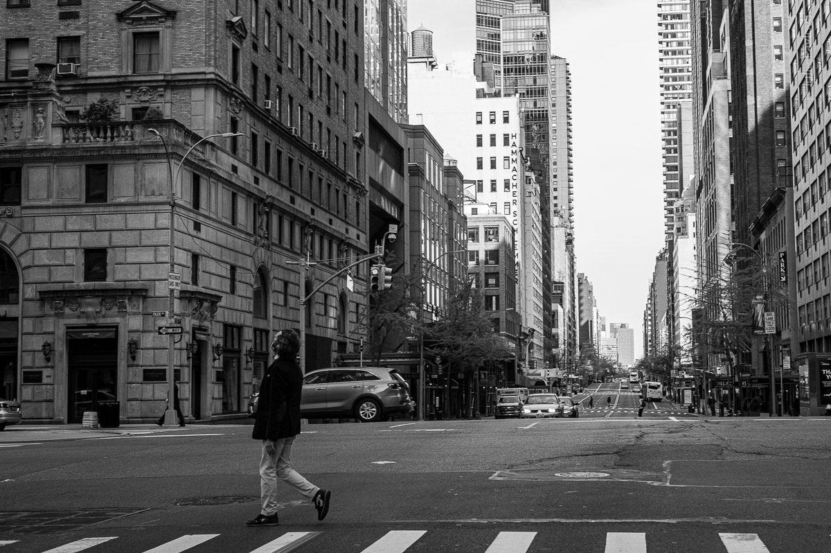 Man crossing a road. Manhattan, New York, during COVID-19. (04/26/2020 by Julie Pavlova Photography)